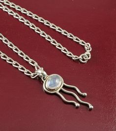 An intricately crafted jellyfish pendant with a moonstone oval set in sterling silver, on a chunky sterling silver curb chain with parrot clasp. Buy it for A$53 (less 10% email signup discount) at Cybelle.com.au