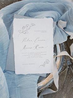 White, gray and blue wedding invitation: Wedding Dress: Claire Pettibone - http://www.stylemepretty.com/portfolio/claire-pettibone-2 Photography: Simply Sarah Photography - http://simplysarah.me Read More on SMP: http://www.stylemepretty.com/2017/02/23/jackson-hole-winter-vow-renewal/