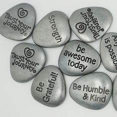 "STRENGTH The Trust Your Journey® uplifting pocket stones go perfectly in your pocket or purse to inspire you through the day! Trust Your Journey on opposite side. 1"" x 1"". Made of Zinc. Imported."