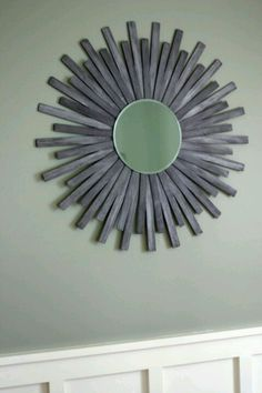 DIY mirror- with shims and an unframed mirror and spray paint it gold or go bold with teal or hot pink!