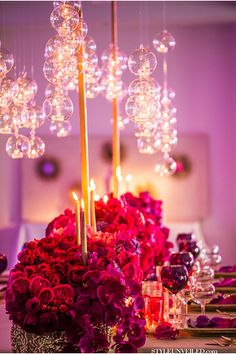 For a chic and modern look, incorporate suspended glass globes into your wedding décor. They will accentuate your centerpieces beautifully and can also be used in escort card arrangements as well.