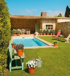 Tile roof stone house, pool, grass. I'loved