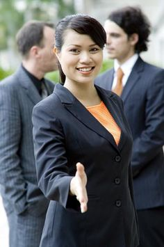 Professional attire, a smile, and firm handshake help you make a winning first impression.