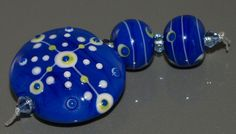 Handmade Blue & White Lampwork Glass Beads by Fluidglassartbeads, £9.45
