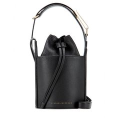 Victoria Beckham - Micro leather bucket bag - The attention to detail is what gives this micro leather bucket bag from Victoria Beckham its distinctive edge. The structured silhouette is coated in grainy black-hued leather with a top that's pulled together by a drawstring and finished with gold-tone accents. We love how the thick leather strap decreases in width for a pristine, streamlined finish. seen @ www.mytheresa.com