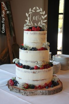 An semi naked wedding cake with fresh fruit. Simple, but still a favourite of many wedding couples. An semi naked wedding cake with fresh fruit. Simple, but still a favourite of many wedding couples. Naked Wedding Cake With Fruit, Berry Wedding Cake, Mini Wedding Cakes, Wedding Cakes With Cupcakes, Making A Wedding Cake, Naked Wedding Cake Recipe, Beautiful Wedding Cakes, Gorgeous Cakes, Nake Cake