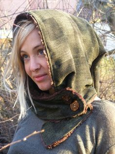 Pixie hood with button- up wrap around neck, lined with soft false fur