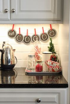 use chalkboard coasters to make a banner for a hot cocoa bar!