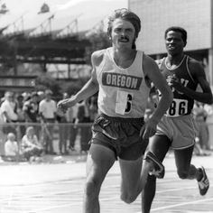 Black and white photo of University of Oregon distance runner Steve Prefontaine on his way to victory, as well as a meet record in the three mile race at the Pac-8 track and field championships held at Hayward Field in May, 1973. This was Prefontaine's final race as an Oregon Duck runner. ©University of Oregon Libraries - Special Collections and University Archives