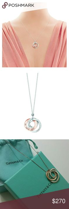 """Interlocking circles pendent necklaces Proudly inscribed with the year Tiffany was founded, the Tiffany 1837? collection is defined by sleek curves and contours. A duo of interlocking circles adds a modern touch to this pendant. RUBEDO? metal and sterling silver Size small On an 18"""" chain Tiffany & Co. Jewelry Necklaces"""