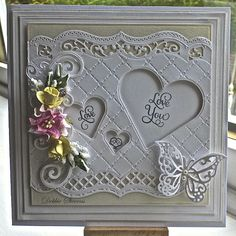 Hi everyone, Todays card measures square so I have used Spellbinders grand squares as my base layers, the top layer I used SB bracket border SB classic hearts, Sue Wilson heart lattice embo. Wedding Anniversary Cards, Wedding Cards, Happy Anniversary, Spellbinders Cards, Engagement Cards, Embossed Cards, Butterfly Cards, Heart Cards, Heartfelt Creations