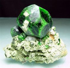 Demantoid :a member of the garnet group of minerals.  Takab, West Azarbaijan Province, Iran (Islamic Republic)  Miniature (4.5-7 cm) Size: H:4.5cm x W:4.9cm x D:2.7cm  Largest Crystal: 2.6cm