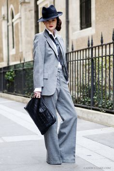 Peony Lim in grey suit and fedora