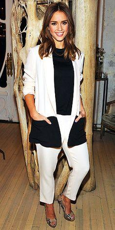 a Jenni Kayne suit, Kate Spade New York sweater, Nicholai by Nicky Hilton ring and Jimmy Choo pumps