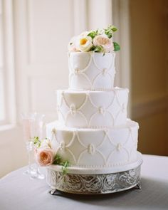 Three-Tiered White Wedding Cake with Icing Beading and Flowers