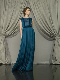 Larusmiani Women Collection FW2013 True Luxury – Look of the week This is Larusmiani woman, wearing a silk blue peacock pleated evening dress with velvet piping.  www.larusmiani.it #larusmiani #handmade #luxuryclothing #lookoftheweek