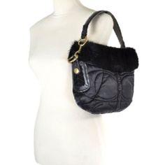 Black coach handbag with real rabbit fur trim Authentic coach handbag. Small. Black with real rabbit fur trim. Gently used. Leather handle. Coach Bags Shoulder Bags