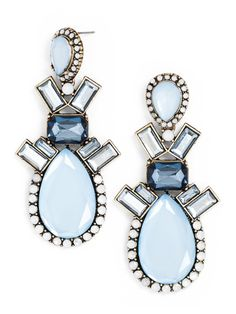 Our best-selling statement earring is toned down with cloudy opaque gems and teardrop-shaped stones. The variation is sophisticated, yet maintains all the personality of the original Opal Galactic.