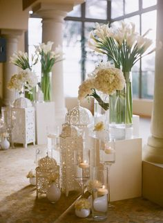 Elegant, sophisticated - pure white wedding decor. A lovely under-stated Indian-y touch with the carved lanterns. :)
