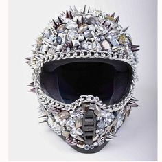 Highway To Hellmet  by Deryck Todd    < Return to Deryck Todd  7  0        $2,400fab        $3,000 retail price      Size      Quantity      Add to Cart    This helmet is a must-have for livin' life in the fast lane! Rule the streets in this fully functioning motorcycle helmet. It's encrusted with giant Swarovski crystals and features hand-placed metal chains and spikes.