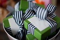 I like striped ribbon; this simple wrapping job is perfect for wedding party gifts.