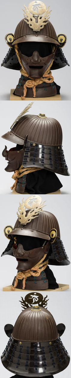 36 plate suji bachi kabuto and menpo, 18th to 19th century, sabinuri urushi, maedate with sanskrit character surrounded of partly engraved flames, golden Mon (coat of arms) on Fukigaeshi (ear-shaped elements) with a stylized Fuji (Wisteria). This Fuji-Mon was famous, especially in connection with the noble house of Fujiwara.