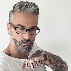 Love the haircut and facial hair.  Normally don't go for salt and pepper look but, it totally works on this guy.
