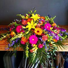 Bold & beautiful casket spray @,Kutchey's (250) Flowers, Midland, MI