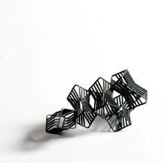 mfayechauhan-9-oxidised-mild-steel-cluster-brooch-from-the-small.jpg 236×236 pixels