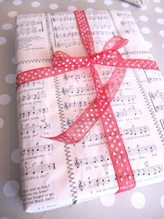 Sew music sheets to make wrapping paper