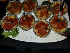 Fettuccine nests topped with homemade meatballs and marina sauce