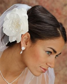 I like this one too. I'm not sure, though, if I want a smaller flower for myself. But the rhinestones on the veil are pretty.