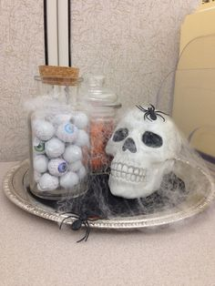 Cute DIY cubicle Halloween decoration Chocolate eye balls from Dollar Tree Glass & skull from Target, a dollar each