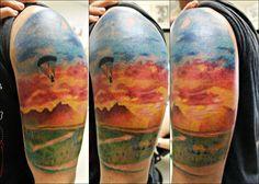 Watercolor landscape with lego figure parachuting | Tattoo.com