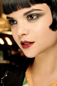 This modern take on a beautiful 20's style look is so wearable. Key features: Classic bob, berry lip, angular cupid's bow, precise brows and smoky eye. #20sMakeup #LousieBrooks