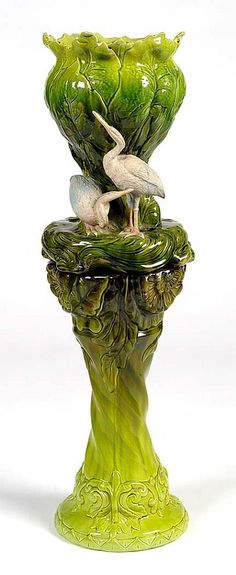 Majolica jardiniere and stand, modelled as two heron and foliage.