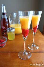Made with raspberries and orange simple syrup, this mimosa is sinfully delicious! Sunrise Mimosa from Wine & Glue #recipe #mimosa