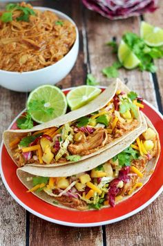Crock Pot Hawaiian BBQ Chicken Tacos with Pineapple Slaw. Pineapple juice, soy sauce, ginger, garlic, brown sugar, vinegar, sriracha, and honey barbecue sauce all flavor the chicken in this super saucy recipe.