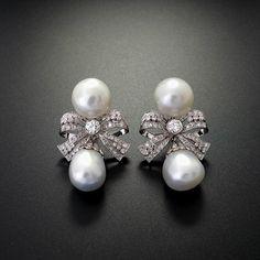 41.pendientes de platino, perlas australianas barrocas y brillantes