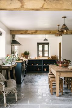 Modern rustic kitchen, tiled floors, wooden beams