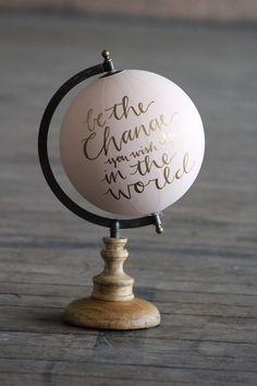 This is a listing for a beautiful hand-painted world globe. Simple and classic in light pink and gold. Be the change you wish to see in the world