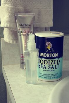 Search your bathroom cabinets and find a spray bottle with a fine mist. Clean it really well. Fill the bottle about 3/4 full with warm water, and add a couple healthy spoonfuls of sea salt. . Shake things up to dissolve the salt. Then fill the remaining space in the bottle with a water-based hair gel. Shake it again. Done and done.