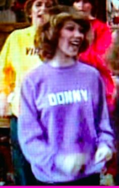 Debbie making her singing debut with her new sister n laws on the Osmond Christmas Show wearing a purple sweat shirt