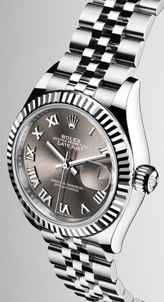 The new Lady-Datejust 28 in a white Rolesor version, combining 904L steel and 18 ct white gold, with a fluted bezel, dark grey sunray finish dial and Jubilee bracelet.