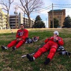 Jeff skinner and Tuomo Ruutu waiting for the bus after practice.  I love how Jeff's helmet is backwards