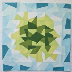 paper pieced blue and green quilt block
