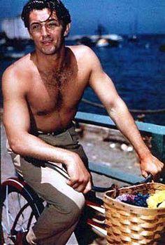 Robert Mitchum rides a bike. Shirtless. When Men were MEN!