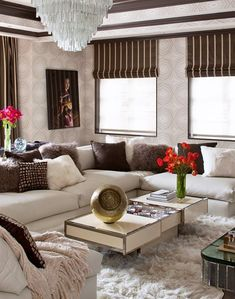 This would be the FAMILY LIVING ROOM, comfortable, cozy yet stylish. (by Martin Lawrence for Tamara Mellon). Love the subtle wallpaper and brown striped curtains combination.