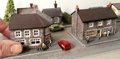 A hand-crafted miniature village. What's the attraction with things miniature?