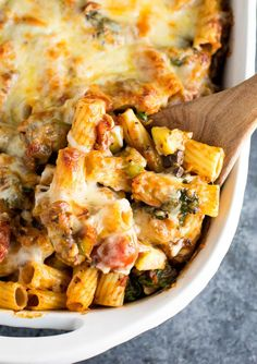 Veggie Lover's Baked Rigatoni recipe made with cherry tomatoes, onions, garlic, mushrooms, bell peppers, zucchini, and spinach. Dinner is served!